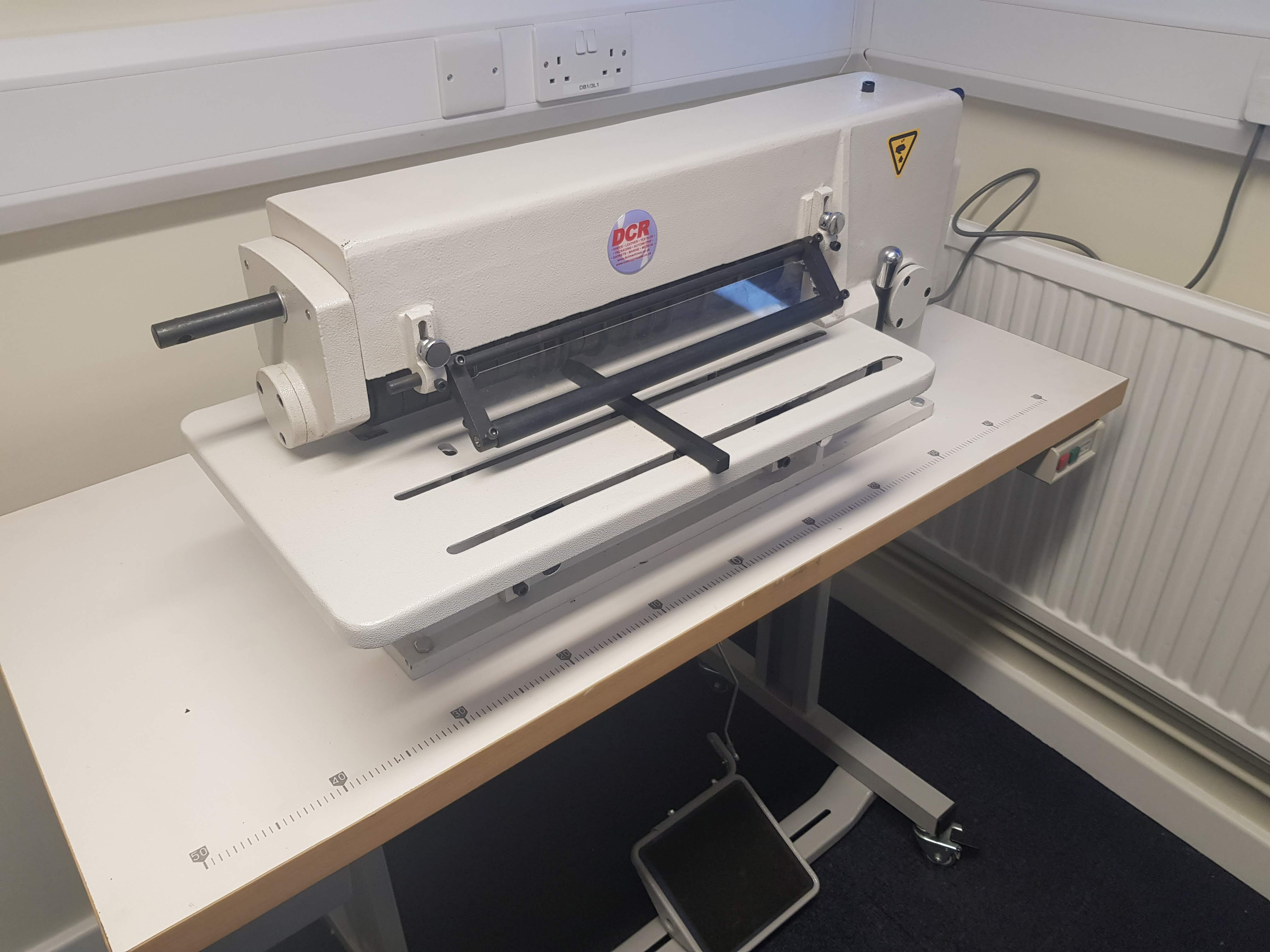 Photo of an DCR-SC400 STRIP CUTTING MACHINE Industrial Sewing Machines